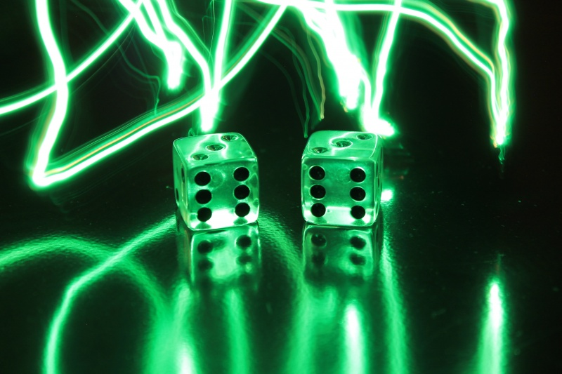 I am new to this site. I'm an amateur photographer. I'm hoping to sell my photos and have them on things like cards, calendars, puzzles etc. This photo is one of a few in the series : Lightning Dice. Straight from the camera. I used Christmas lights.