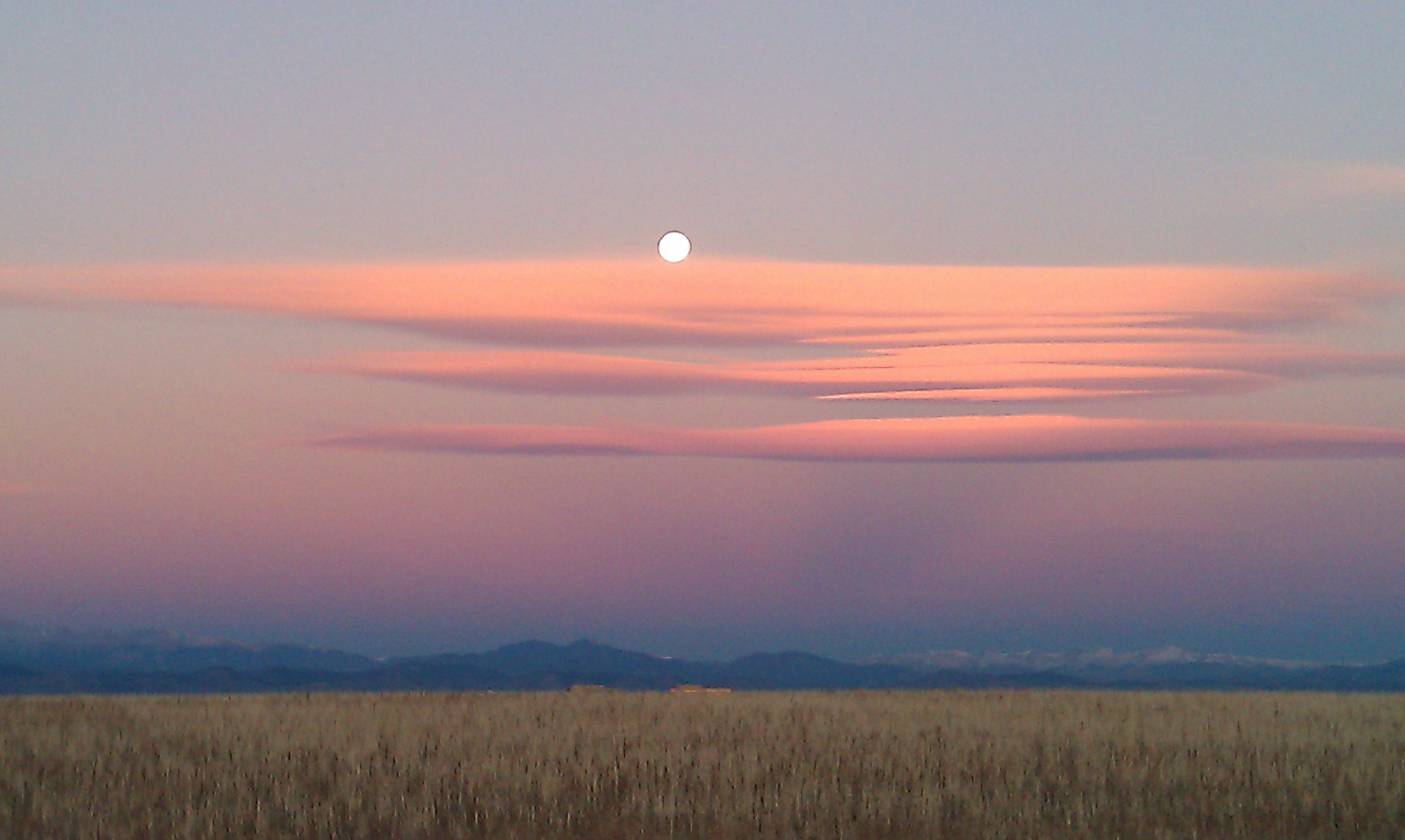 The setting moon over clouds