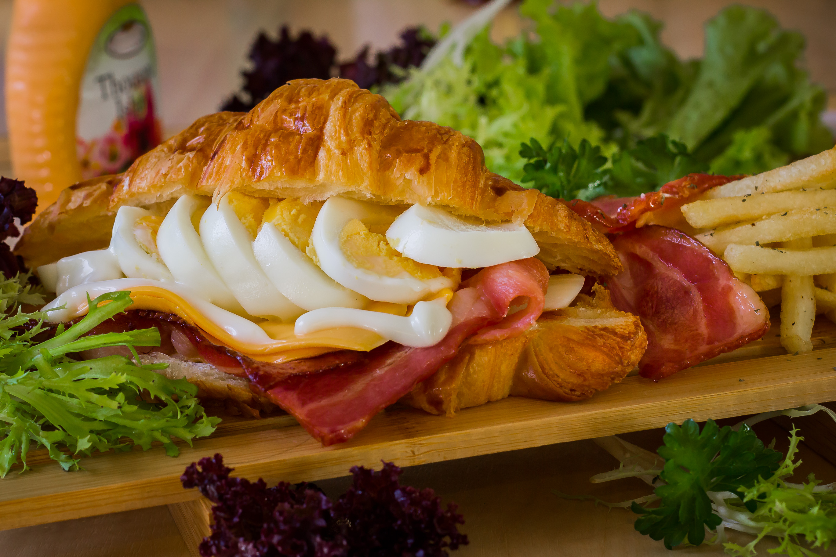 Croissant with bacon and egg